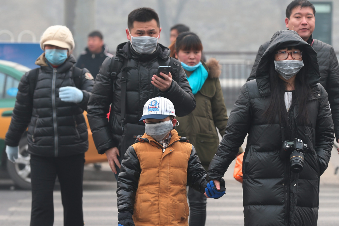 South China Morning Post family walking with face masks.png